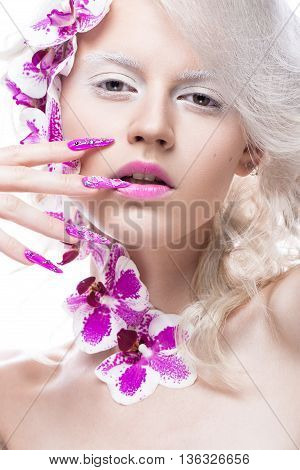 Beautiful girl with art make-up, flowers, curls and long nails. Manicure design. The beauty of the face. Photos shot in studio