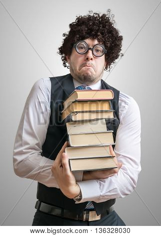 Nerd Man Holds Many Books In Hands.