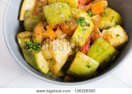 Fried zucchini stew in a ceramic bowl