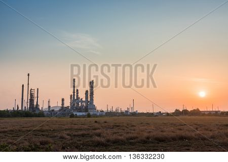 Oil Refinery Factory In Morning Sunrise