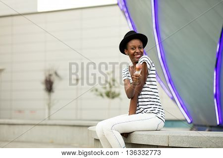 Young Black Woman Eating Icecream