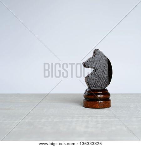 Black Horse On White Table