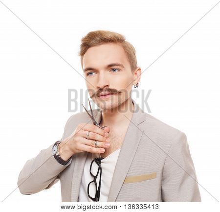 Hairdresser, wearing jacket, posing with scissors. Guy cutting his mustache. Stylish man studio portrait, isolated at white background. Barber with vintage facial hair style.