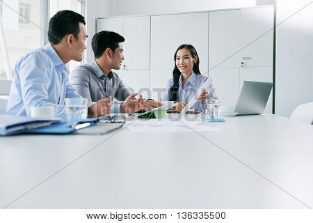Young Asian business team having meeting in office