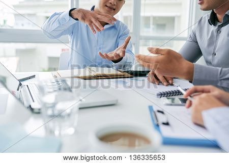 Businessman explaining his idea to colleague, selective focus