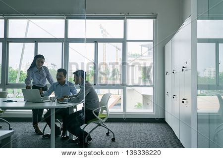 Vietnamese business team having meeting in office