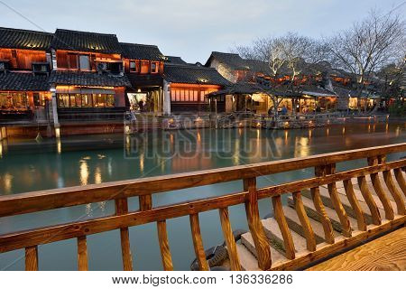 WUZHEN CHINA - MARCH 24: Night scene of Wuzhen on March 24 2016 in Wuzhen China. Wuzhen is a historic scenic town located in northern Zhejiang Province China