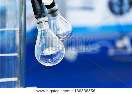 Glass Bulb On A Rotary Laboratory Evaporator. Industrial Background.