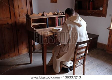 PLETERJE, SLOVENIA - NOVEMBER 06: The monks studying reading old medieval books in the Carthusian monastery in Pleterje, Slovenia on November 06, 2015.