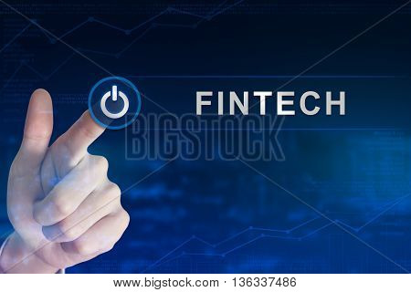 double exposure business hand clicking fintech or financial technology button with blurred background