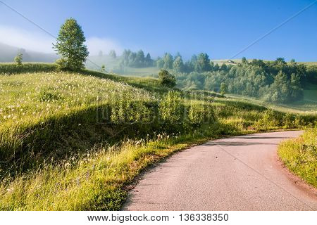 Colorful morning mist up the hills in the Romanian Apuseni Mountains near Salciua