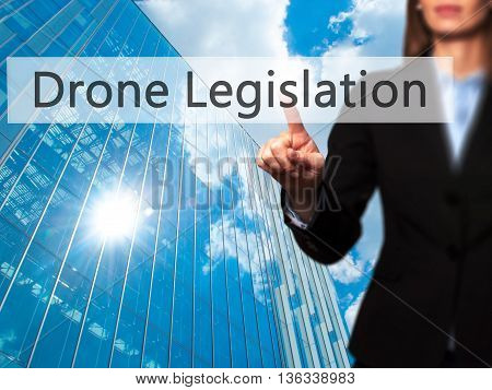 Drone Legislation - Businesswoman Hand Pressing Button On Touch Screen Interface.