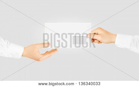 White blank envelope giving hand. Envelope mockup design presentation.
