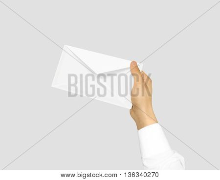 White blank envelope mock up holding in hand. Empty post document design mockup. Clear email display presentation in hands. Postcard template ready for your logo identity design. Closed, front layout.