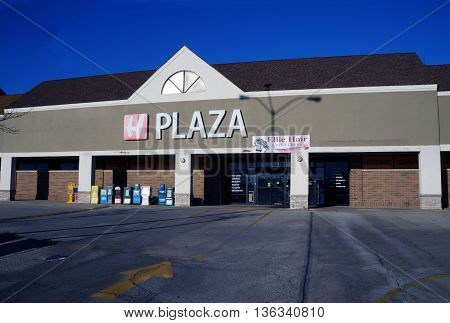 NAPERVILLE, ILLINOIS / UNITED STATES - NOVEMBER 3, 2015: H Plaza includes a food court, a hair salon, and retail shops, adjacent to the Super H-Mart Korean supermarket in Naperville.
