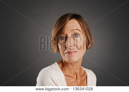Face of senior woman looking at camera