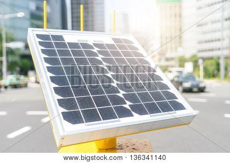 solar panel on street in tokyo with sunbeam