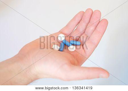 A hand full of medicines pills health