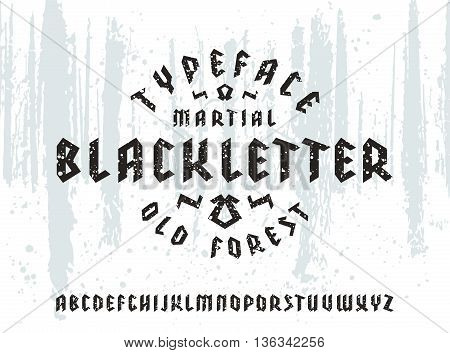 Sanserif font in black letter style with spray texture. Gothic typeface on forest texture background