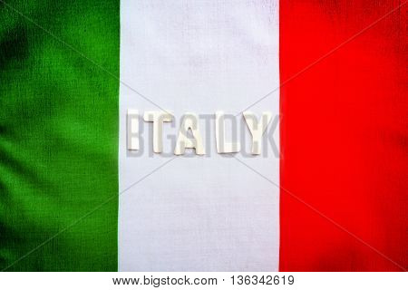 Closeup photo of a Italian flag, abstract grunge background with text space, patriotic wallpaper, background for football fans