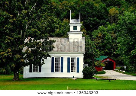 West Arlington Vermont - September 19 2014: The United Methodist Church on the Green and 1852 covered bridge over the Battenkill River