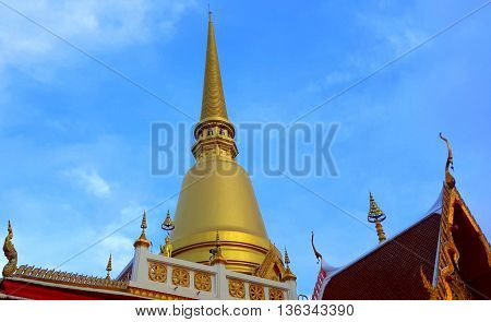 golden chedi tower of Buddha relics at Buddhist temple, Songkhla, Thailand