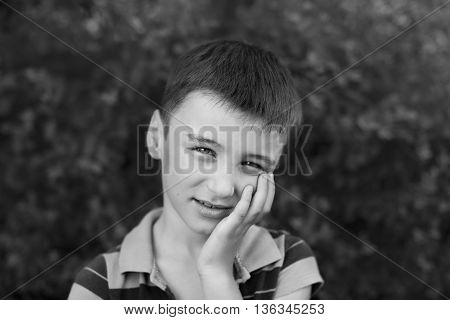 Portrait of a boy close up in nature