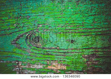 The cut , the texture of wood , covered with old paint