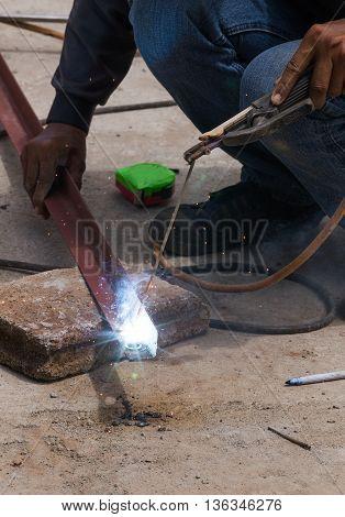 Welder Working A Welding Metal