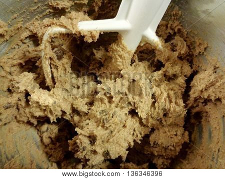 Chocolate chip cookie dough in mixing bowl