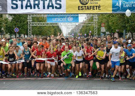 VILNIUS LITHUANIA - SEPTEMBER 14: Runners on start of the 10 km and 5 km tracks of 11th Danske Bank Vilnius Marathon on 14 September 2014 in Vilnius Lithuania