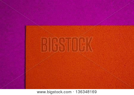 Eva foam ethylene vinyl acetate orange surface on pink sponge plush background
