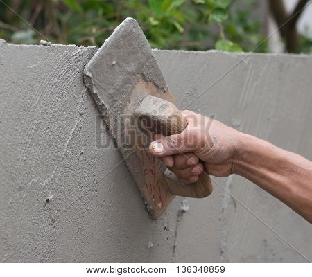 Worker Use Trowel Plastering Concrete At Wall
