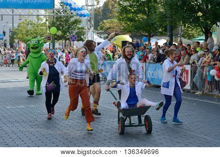 VILNIUS LITHUANIA - SEPTEMBER 14: Unidentified runners at Vilnius Marathon on 14 September 2014 in Vilnius Lithuania. Vilnius Marathon is one of most popular sport events in Lithuania.