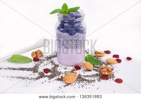 Chia seeds pudding with blueberries, yogurt and fresh strawberries. A healthy and wholesome breakfast or snack.
