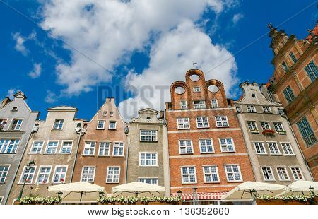 Facades of old medieval houses on the waterfront in Gdansk.