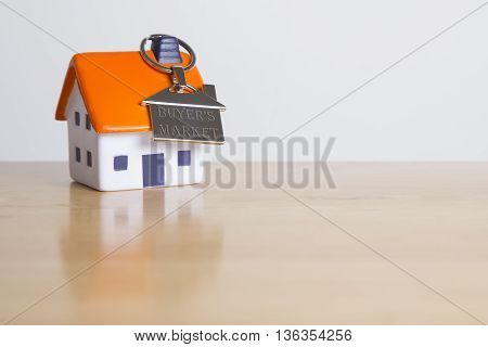 Buyer's market digitally engraved on silver keyring - mortgage concept