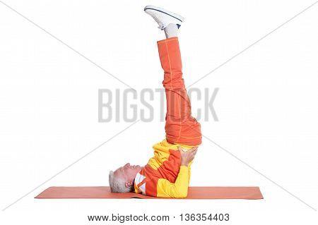 Senior man exercising on a white background