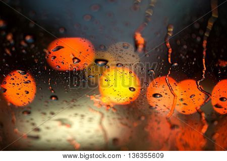 Selective Focus Of Raindrop On The Window Of The Car