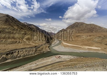 Top view of confluence of rivers Indus and Zanskar looks enticing from hill road going towards Nemo village.Leh Ladakh India