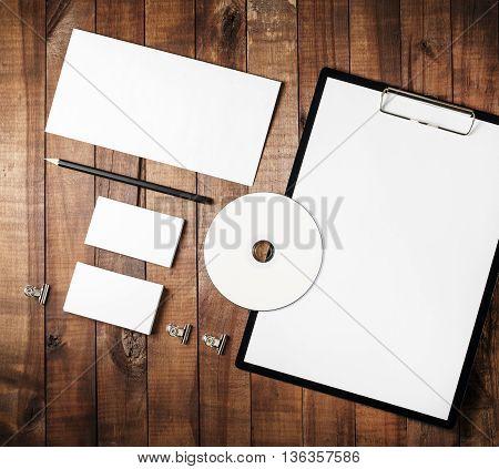 Blank stationery set. on vintage wooden background. Photo of blank stationery set. Responsive design template. Mock-up for your design.