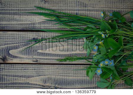 Green Wildflowers Arrangement On Wood
