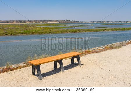 Bench On Water Edge