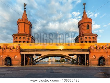Closeup of the Oberbaum Bridge in Berlin, Germany, with passing by train