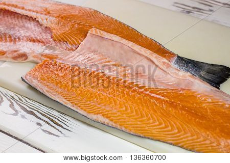 Red meat of raw fish. Fish meat on cooking board. Fillet of salmon for sushi. Seafood high in nutrients.