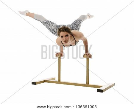 Acrobatics. Pretty girl poses while doing handstand