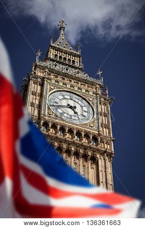 British union jack flag and Big Ben Clock Tower at city of westminster in the background