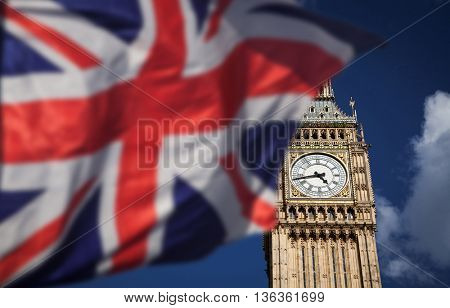 British union jack flag and Big Ben Clock Towe at city of Westminster in the background