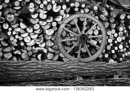 Pile Of Chopped Wood With A Wheel