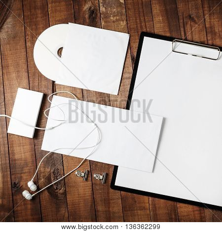 Blank template for ID. Blank stationery and corporate identity template on wooden table background. Responsive design mock-up.